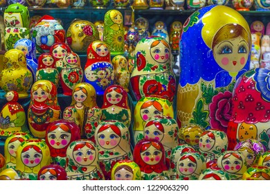 MOSCOW, RUSSIA - The Red Square December 2017: Traditional Russian national souvenir doll-matryoshka A lot of Matryoshka at souvenir market shop. Different colors Russian dolls. Traditional classic