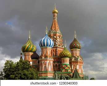MOSCOW, RUSSIA - Restored Colorful Onion Domes and Red with White Capels of St. Basil's Cathedal (Intercession Cathedral on the Moat) Under the Grey Clouds.
