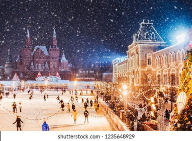 Moscow, Russia.  Saint Basil's Cathedral on the background.  Christmas holidays, snowy winter night landscape. Christmas fair on Red Square. Festively decorated Red Square in snow. Christmas Market.