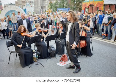 MOSCOW, RUSSIA - SEP 10, 2017: String quartet and singers on Tverskaya Street during celebration 870th anniversary of Moscow.