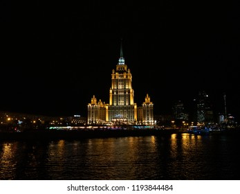 Moscow, Russia - Sep 27, 2018: The Hotel Ukraine reflected in the Moscow River. Stalinist Empire style.
