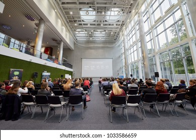 MOSCOW, RUSSIA - SEP 30, 2017: People participants of conference Day of Internet Advertising listen to speaker in auditorium of Headquarters Mail.Ru Group.