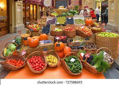 "MOSCOW, RUSSIA - SEPT 17, 2017: Vivid fair of farm products ""Taste Russian"" was opened in GUM (State Department Store). Autumn harvest. Fruits and vegetables"