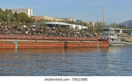 MOSCOW, RUSSIA - SEPT 17, 2017: Pushed barge full of industrial trash being transported on Moscow river in city center