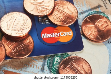 Moscow, Russia - September 03, 2018: Mastercard credit plastic card with usa money