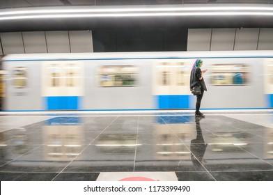 MOSCOW, RUSSIA - SEPTEMBER 05, 2018: Alone passenger on the subway station Ozernaya