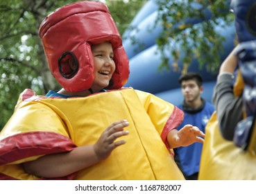 MOSCOW, RUSSIA - September 06, 2014:Boys in sumo suits are struggling. City Day celebrations in Moscow.