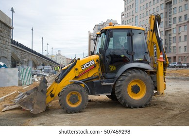MOSCOW, RUSSIA - SEPTEMBER 07, 2016: The JCB-3CX excavator loader on reconstruction of an automobile outcome at Bolshoy Kamenny Bridge. Moscow, Russia
