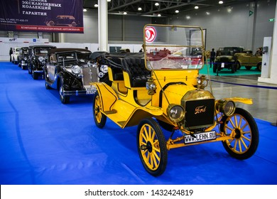 Moscow, Russia - September 1, 2016: Yellow vintage car Ford model T Tourabout presented at the annual Moscow International Motor Show MIMS-2016.