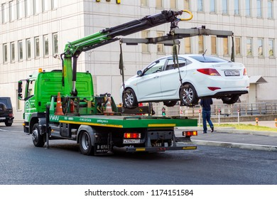 Moscow, Russia - September 1, 2018: Evacuation of an incorrectly parked car. Evacuation is carried out by the State Treasury of the city of Moscow - the Center for Traffic Management.