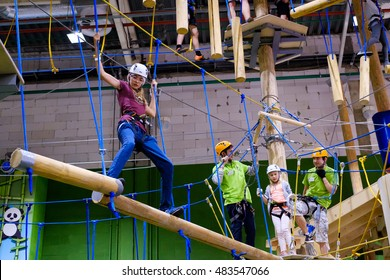 Moscow, Russia - September 10, 2016: Children age 6-12 attend indoor adventure climbing park at day time