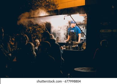 MOSCOW, RUSSIA - SEPTEMBER 10, 2016: Busy evening hours at a street food market in one of the parks of Moscow, Russia.