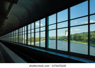 MOSCOW, RUSSIA - SEPTEMBER 10, 2017: The train coming in the Vorobyovy gory station. In the Sokolnicheskaya line red line with river view in Moscow