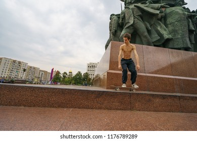 Moscow / Russia - September 10 2018: A skateboarder performs a stunt near the Lenin monument on a Kaluzhskaya square in Moscow