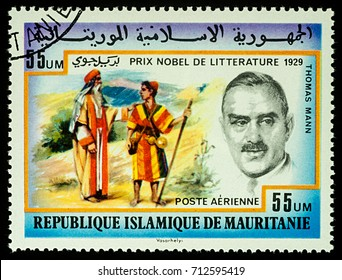 """Moscow, Russia - September 11, 2017: A stamp printed in Mauritania, shows portrait of German writer Thomas Mann (1875-1955), series """"Nobel prize winners"""", circa 1977"""