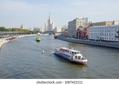 Moscow, Russia - September 12, 2017: Moskvoretsky and Raushskaya embankments and high-rise building on Kotelnicheskaya embankment. Pleasure ships floating on the Moscow-river
