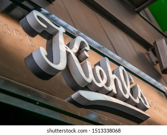 Moscow, Russia - September 14, 2019: Shop advertising sign with the Kiehls logo. Kiehl's LLC is an American cosmetics brand retailer that specializes in skin, hair, and body care products