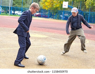 MOSCOW, RUSSIA - September 15, 2012: Boys after school play football. Daily life in Moscow.
