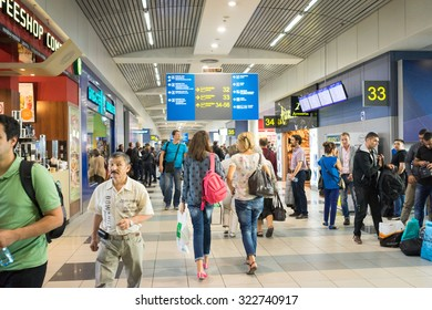 Moscow, Russia - September 15, 2015: People walking inside terminal of Domodedovo Airport - the largest and modern airport of Russia.
