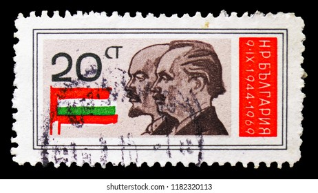 MOSCOW, RUSSIA - SEPTEMBER 15, 2018: A stamp printed in Bulgaria shows Lenin, Dimitrov, National Flags, 25th Aniversary of People Republic serie, circa 1969