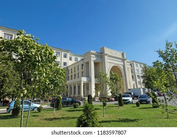 Moscow / Russia - September 15, 2018: Moscow Institute of Physics and Technology (MIPT), one of top-rated Russian universities. White Laboratory Building and some plants around.  Sunny autumn day.