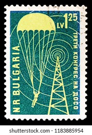 MOSCOW, RUSSIA - SEPTEMBER 15, 2018: A stamp printed in Bulgaria shows Parachutists and Transmission Tower, Congress of the Aid Organization DOSO serie, circa 1959