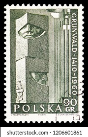 MOSCOW, RUSSIA - SEPTEMBER 15, 2018: A stamp printed in Poland shows Detail from Grunwald monument, 550th anniversary of battle of Grunwald serie, circa 1960