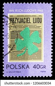 "MOSCOW, RUSSIA - SEPTEMBER 15, 2018: A stamp printed in Poland shows ""The People's Friend"" and Clover, ""Popular Movement"" In Poland, 70th Anniversary serie, circa 1965"
