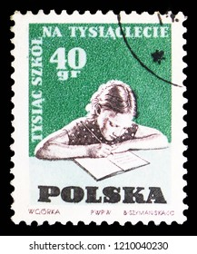 MOSCOW, RUSSIA - SEPTEMBER 15, 2018: A stamp printed in Poland shows Child doing homework, 1000 schools on 1000th Anniversary of Poland serie, circa 1959
