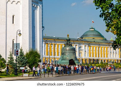 Moscow, Russia - September 15, 2018: Tourists visiting the Kremlin. Inside there is a giant bell in front of a cathedral