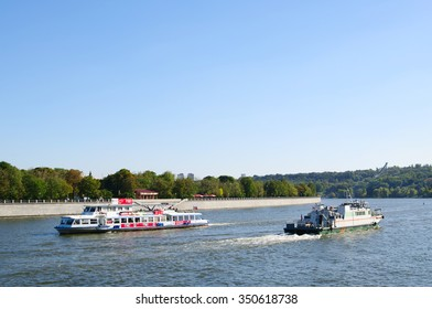Moscow, Russia - September 16, 2014: pleasure boat and green patrol boat  floating on Moskva-river  along Luzneckay embankment