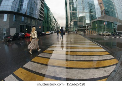 Moscow, Russia - September 18, 2019: Workout time. Working day had been finished, people leave office. MIBC Moscow International Business Center. Rain autumn business concepts. Fish-Eye technique lens