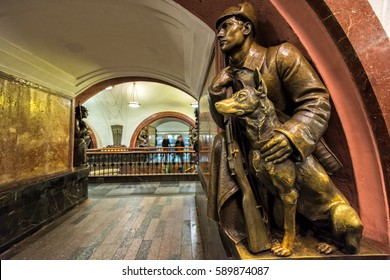Moscow , Russia - September 19, 2016:The bronze sculpture of a frontier guard with a dog  in Ploshchad Revolyutsii subway station.