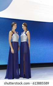 MOSCOW, RUSSIA - SEPTEMBER 2, 2014: Moscow international automobile salon. Beautiful girls in matching dresses.