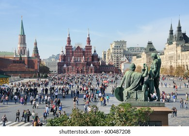 MOSCOW, RUSSIA - September 20, 2014 Crowded Red Square at Nice Autumn Day - Panorama of the Red Square from St. Basil's Cathedral. Monument to Minin and Pozharsky looks very impressive in this picture
