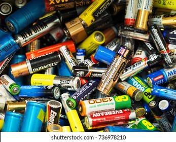 MOSCOW, RUSSIA - SEPTEMBER, 2017 Used batteries from different manufacturers, waste, collection and recycling, high danger for the environment. Batteries background