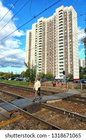 MOSCOW, RUSSIA - SEPTEMBER, 2018: People cross the railway on the transition.