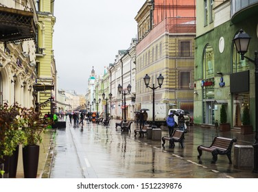 Moscow, Russia - September 2019. Beautiful pedestrian streets of Moscow in autumn in rainy weather. Rain on the streets. Tourists and city residents visiting the sights.