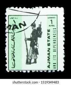 MOSCOW, RUSSIA - SEPTEMBER 22, 2019: Postage stamp printed in Ajman State shows Flagpole - France, 1913, Military uniforms, small size serie, circa 1972