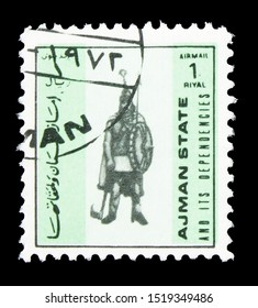 MOSCOW, RUSSIA - SEPTEMBER 22, 2019: Postage stamp printed in Ajman State shows Guard of Clovis I - France 482-511, Military uniforms, small size serie, circa 1972