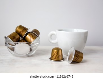 MOSCOW, RUSSIA - SEPTEMBER 23, 2018: Cup of Coffee Nespresso Capsules Limited Collection Nespresso Master Origin Nicaragua on White Wall Background Natural Light Selective Focus