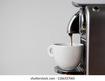 MOSCOW, RUSSIA - SEPTEMBER 23, 2018: Coffee Espresso Pouring from Nespresso Coffee Machine. Nespresso is Worldwide Company of Coffee Products.