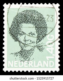MOSCOW, RUSSIA - SEPTEMBER 23, 2019: Postage stamp printed in Netherlands shows Queen Beatrix (1938-), Type 'Struycken' serie, circa 1982