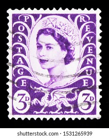 MOSCOW, RUSSIA - SEPTEMBER 23, 2019: Postage stamp printed in United Kingdom shows Queen Elizabeth II, Wilding Portrait, Regional - Wales serie, circa 1958
