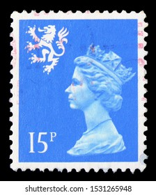 MOSCOW, RUSSIA - SEPTEMBER 23, 2019: Postage stamp printed in United Kingdom shows Queen Elizabeth II, 15p Machin Portrait, Regional - Scotland serie, circa 1989
