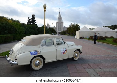 MOSCOW, RUSSIA - SEPTEMBER 24, 2011: Old timer cars rally start - soviet 1940s car GAZ-M20 Pobeda Cabriolet nearby Moscow State University.