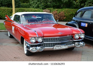 MOSCOW, RUSSIA - SEPTEMBER 24, 2011: Old timer cars rally start - classic american Cadillac Eldorado car in bright red color