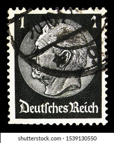 MOSCOW, RUSSIA - SEPTEMBER 24, 2019: Postage stamp printed in German Realm shows Paul von Hindenburg (1847-1934), 2nd President, 1 German reichspfennig, In the medallion serie, circa 1933
