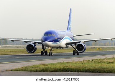 MOSCOW, RUSSIA - SEPTEMBER 26, 2014:  Airbus A320 Azerbaijan Airlines taxiing after landing at Domodedovo International airport.