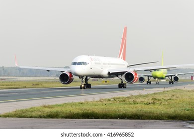 MOSCOW, RUSSIA - SEPTEMBER 26, 2014: RoyalFlight Boeing 757 and  Airbus A 320 S7 airlines. Two aircraft moving on taxiway at Domodedovo arport.